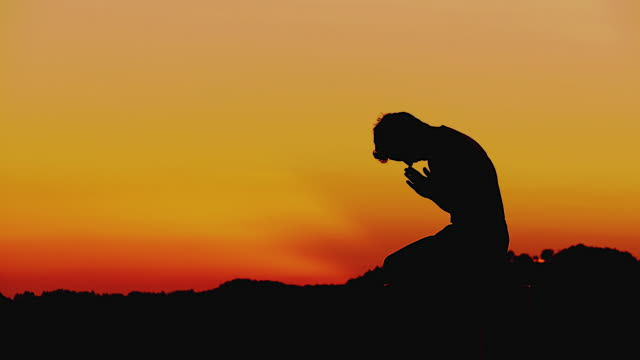 Image result for man praying sunset